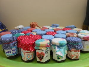 The finished jam- complete with labels and jam jar fabric topper.